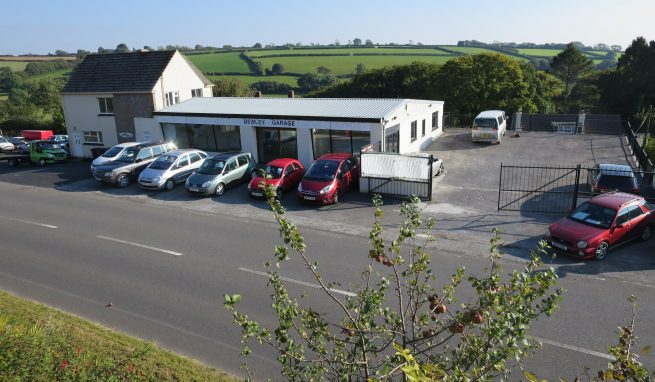 Investment Premises comprising a Car Showroom which is vacant, plus range of Garage and Workshops plus 2 One Bedroom Flats
