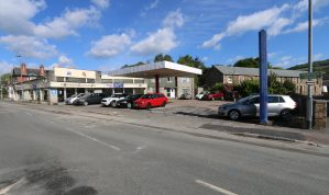 Well located Garage premises with extensive Showrooms, Workshops and Forecourt plus a spacious 4 Bedroom House on a site of 0.6 of an Acre and suitable for Residential Development (STP)
