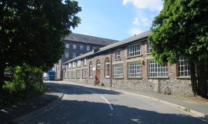 Substantial Industrial Premises with Offices, Car Parking, a rear Yard plus additional Yard area to the front with further development potential (Subject to planning)