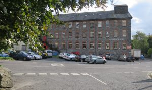 Substantial 5 storey stone former Mill Building with ample Car Parking in a convenient town centre location in Buckfastleigh near the A38